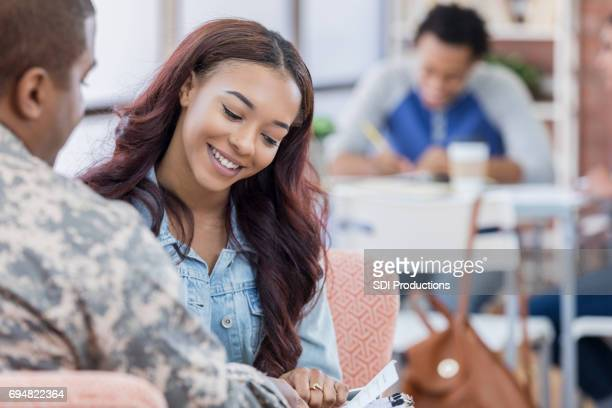 College student talks with military recruiter