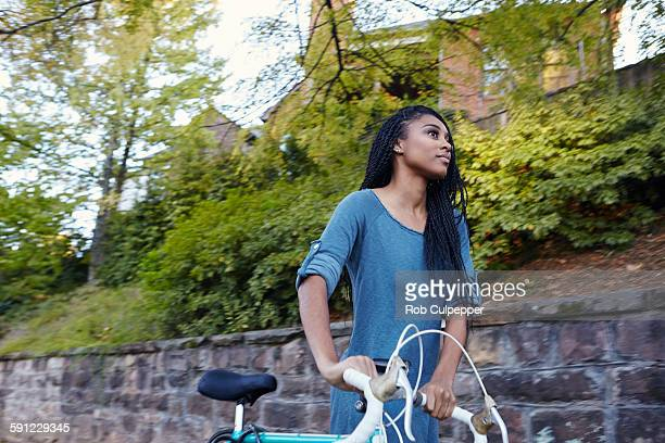 College student walking with bicycle