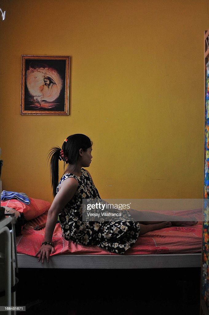 A college student who became pregnant after a sexual assault rests at Nazareth House on May 10, 2013 in Manila, Philippines. The Nazareth home take in women who are expecting mothers and have no capacity to raise a child due to varied socio-economic reasons. Women in the center usually have suffered mental or sexual abuse and undergo a series of counseling and are also provided maternal health support by the volunteers.