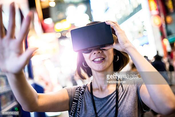 college student woman using the VR simulator in Tokyo