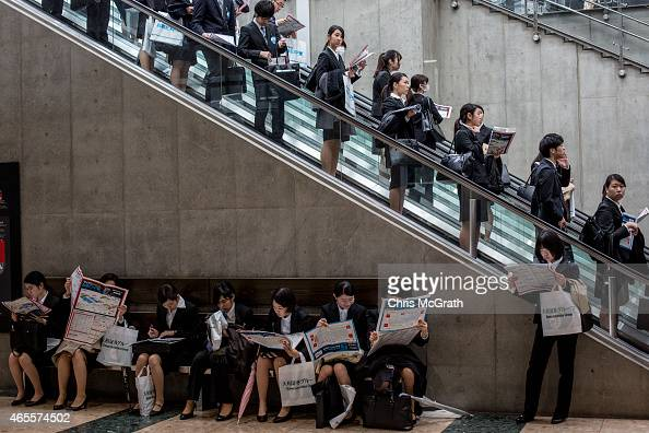 College students arrive to attend the Mynavi Shushoku MEGA EXPO at the Tokyo Big Sight on March 8 2015 in Tokyo Japan 70000 jobseeking students are...