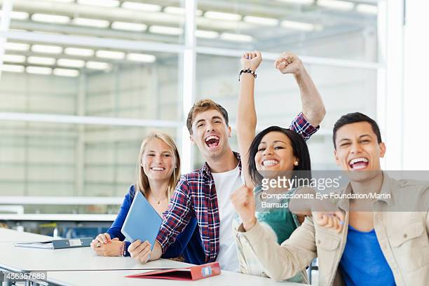 College students celebrating in cafeteria