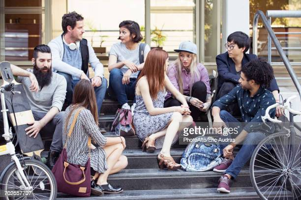 College students chatting on stairs