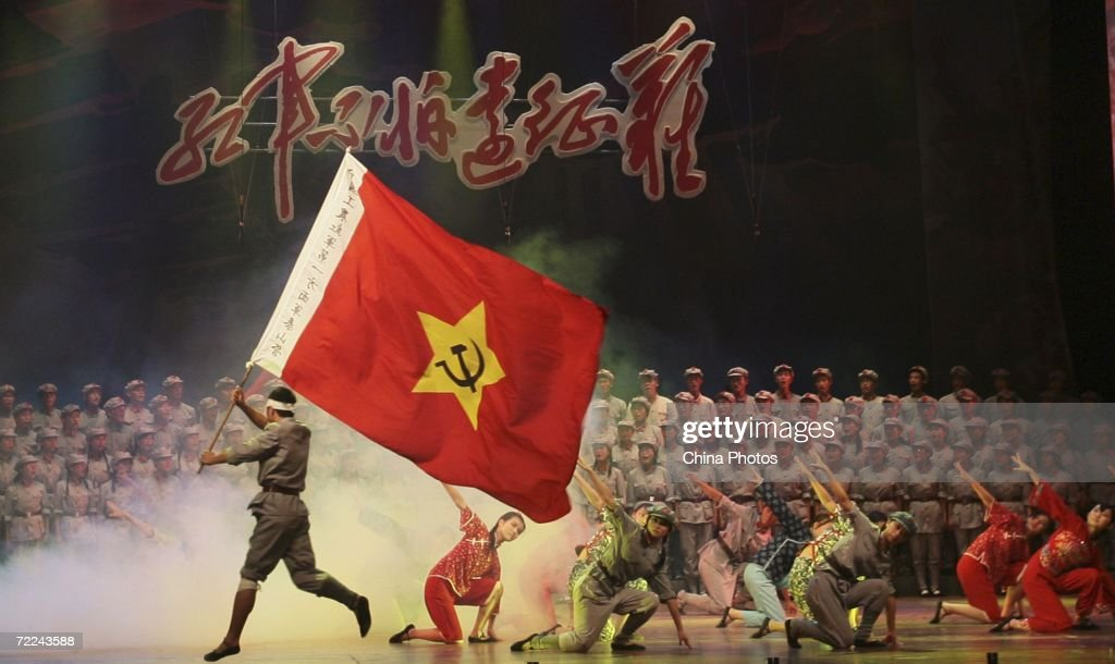 College students dance during an evening to mark the 70th anniversary of the successful completion of the Long March on October 23, 2006 in Nanjing of Jiangsu Province, China. The Long March was a massive military retreat undertaken by the Red Army of the Communist Party from 1934 to 1936, to evade the pursuit of the Kuomintang army. The route branched through some of the most difficult terrain of western China and covered about 9,600 km (5,961 miles).