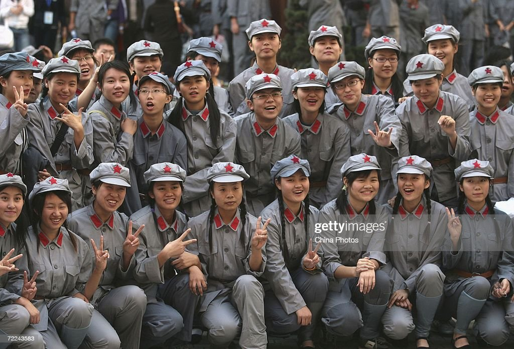 College students dressed as the Red Army soldiers pose for pictures after evening to mark the 70th anniversary of the successful completion of the Long March, after their performance on October 23, 2006 in Nanjing of Jiangsu Province, China. The Long March was a massive military retreat undertaken by the Red Army of the Communist Party from 1934 to 1936, to evade the pursuit of the Kuomintang army. The route branched through some of the most difficult terrain of western China and covered about 9,600 km (5,961 miles).