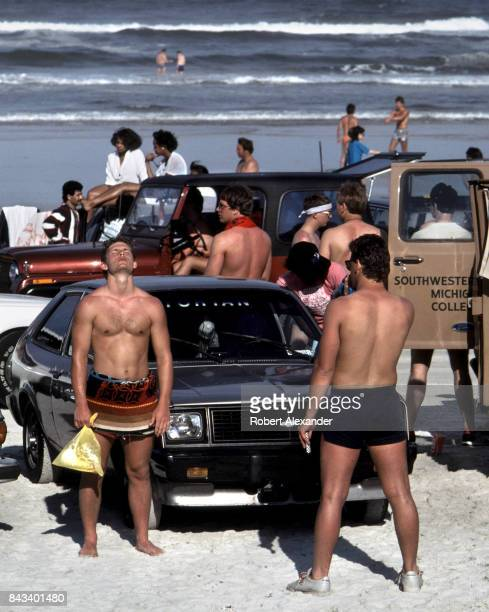 College students enjoy the sun and surf at Daytona Beach Florida during the 1983 Spring Break
