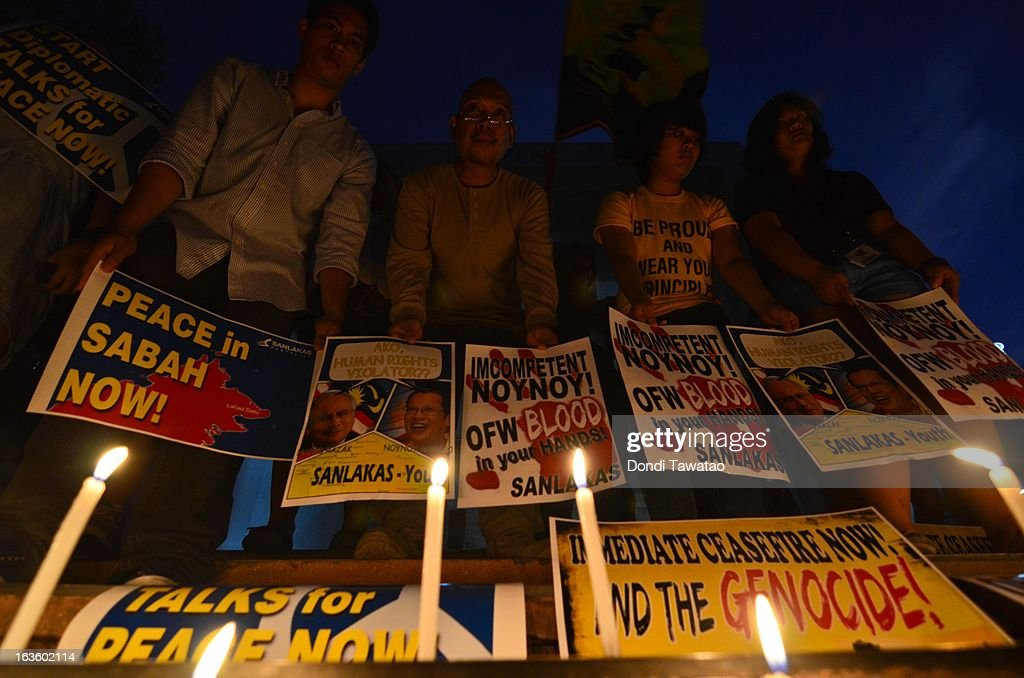 College students from the University of the Philippines hold a candlelight peace vigil calling for an end to hostilities in Sabah on March 13, 2013 at the State University campus in Quezon City, Philippines. Around 61 fatalities have already been reported in bloody clashes between 200 armed followers of self-proclaimed Sultan of Sulu Jamalul Kiram III and Malaysian security forces since March 5. UN Secretary General Ban Ki Moon has called for a ceasefire to the conflict which has also displaced thousands in affected areas and has triggered an exodus of Filipino workers and families towards neighboring Sulu province in the Philippines. The Filipino gunmen, from the restive southern provinces of Sulu and Tawi-Tawi in Mindanao, crossed over to neighboring Sabah last February 12 to lay claim to territory as ancestral land, triggering a standoff and clashes with Malaysian security forces.