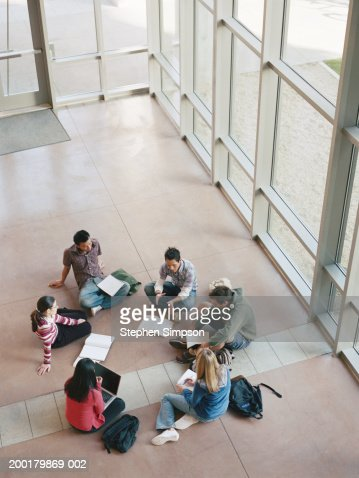 College students having group discussions, elevated view : Stock Photo