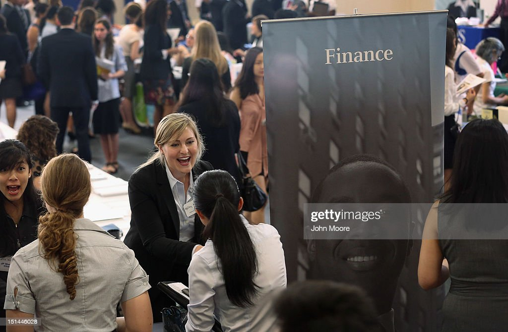 College students meet representatives of J.P. Morgan at the Barnard College Career Fair on September 7, 2012 in New York City. Barnard, which is the undergraduate women's college of Columbia University, hosted the job and internship fair with nearly 100 companies and organizations meeting with hundreds of Barnard and Columbia students looking for work.