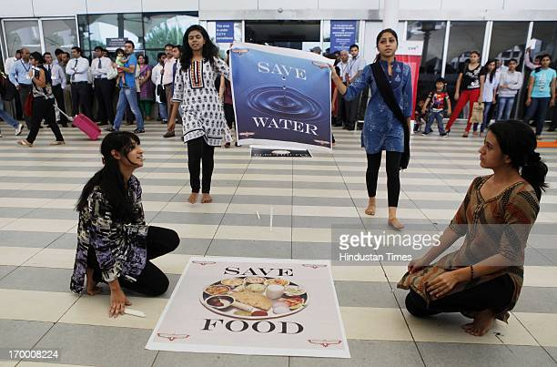 College students perform unique street play and flash mob to highlight energy conservation and food waste at Domestic Airport during the World...
