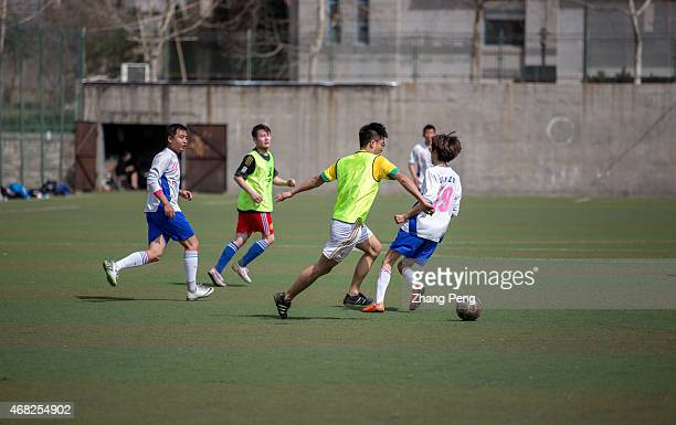 College students play a football game in campus on a Sunday afternoon China has issued a football reform plan to boost the development of the sport...