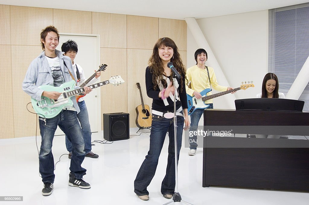 College Students Playing the Band : Stock Photo