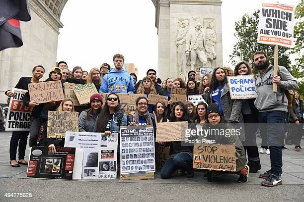 College students pose with signs in front of Washington Square arch prior to marching More than one thousand activists marched on behalf of the...