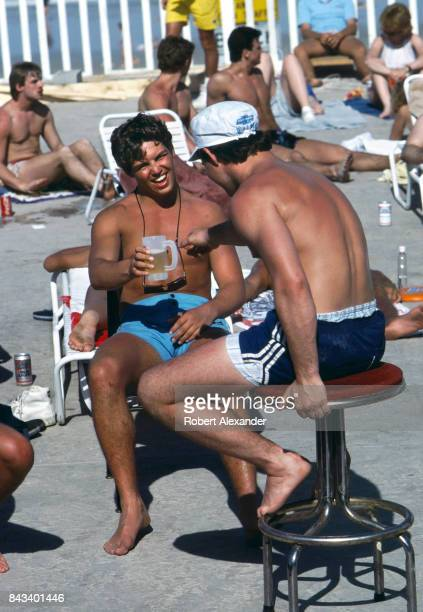 College students share a beer on a hotel patio during Spring Break 1983 in Daytona Beach Florida