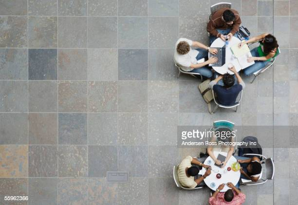 College students sitting at tables