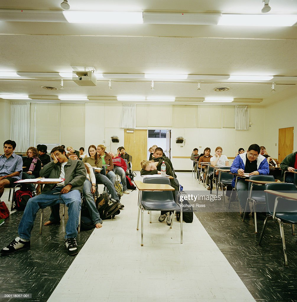 College students sitting in classroom : Stock Photo