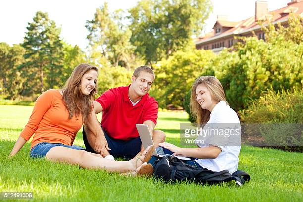 College Students Sitting Outdoor on University Campus