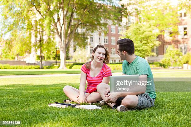 College Students Studying Outdoor Together on University Campus