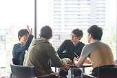College students are discussing at a lounge of research facilities