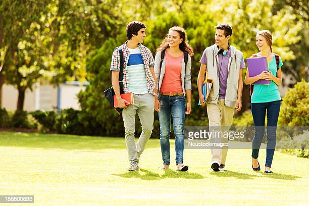 College students walking on campus lawn