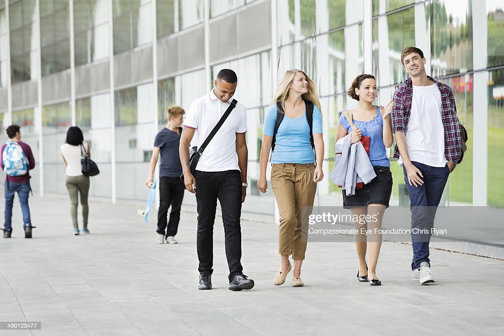 College students walking outdoors : Stock Photo
