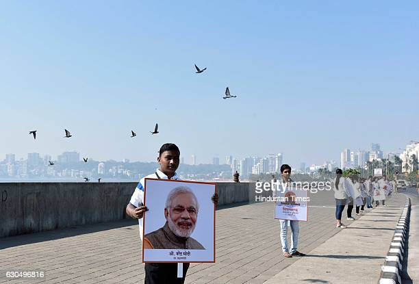 College students welcome Prime Minister Narendra Modi as he arrived at Girgaum Chowpatty to lay the foundation of the Shiv Smarak in the Arabian Sea...