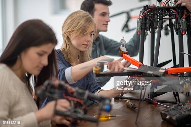 College Students Working on a Drone