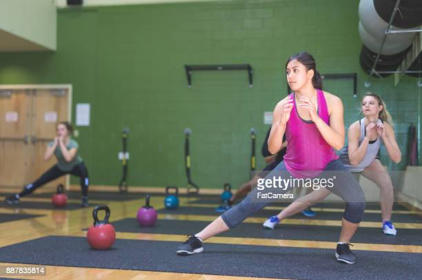College students working out in fitness class together