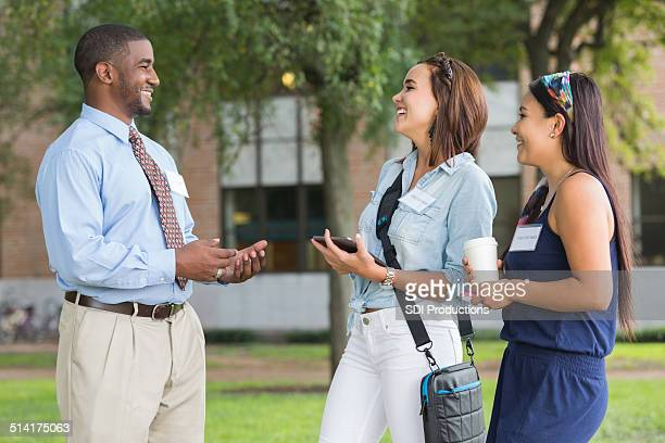 College tour guide talking with visiting students on campus