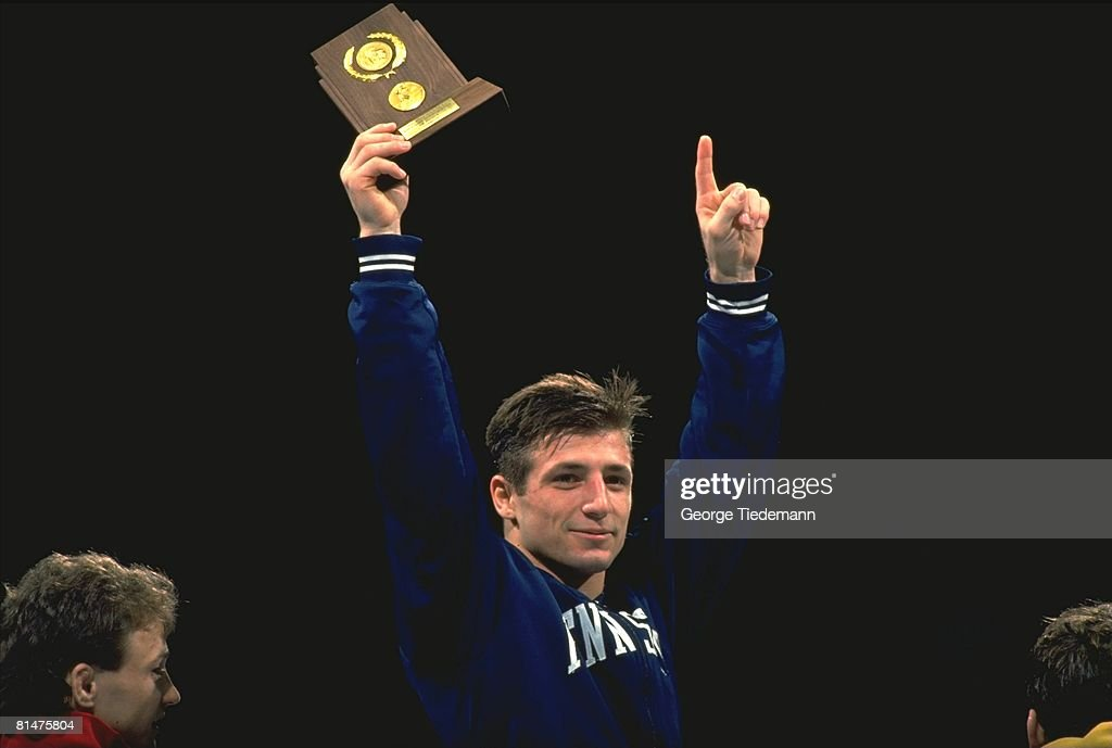 NCAA Championships, Closeup of Penn State Jeff Prescott victorious with trophy after winning 118 lb match, Iowa City, IA 3/15/1991