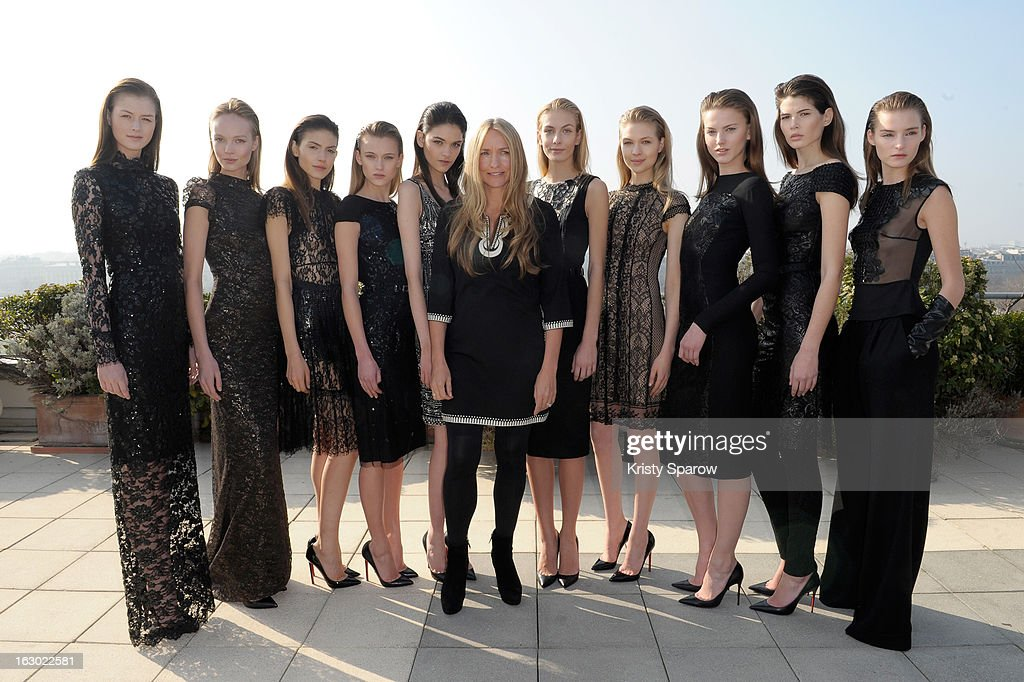 Collette Dinnigan poses with models during the Collette Dinnigan 2013/14 Ready-to-Wear show as part of Paris Fashion Week at Le Meurice on March 3, 2013 in Paris, France.