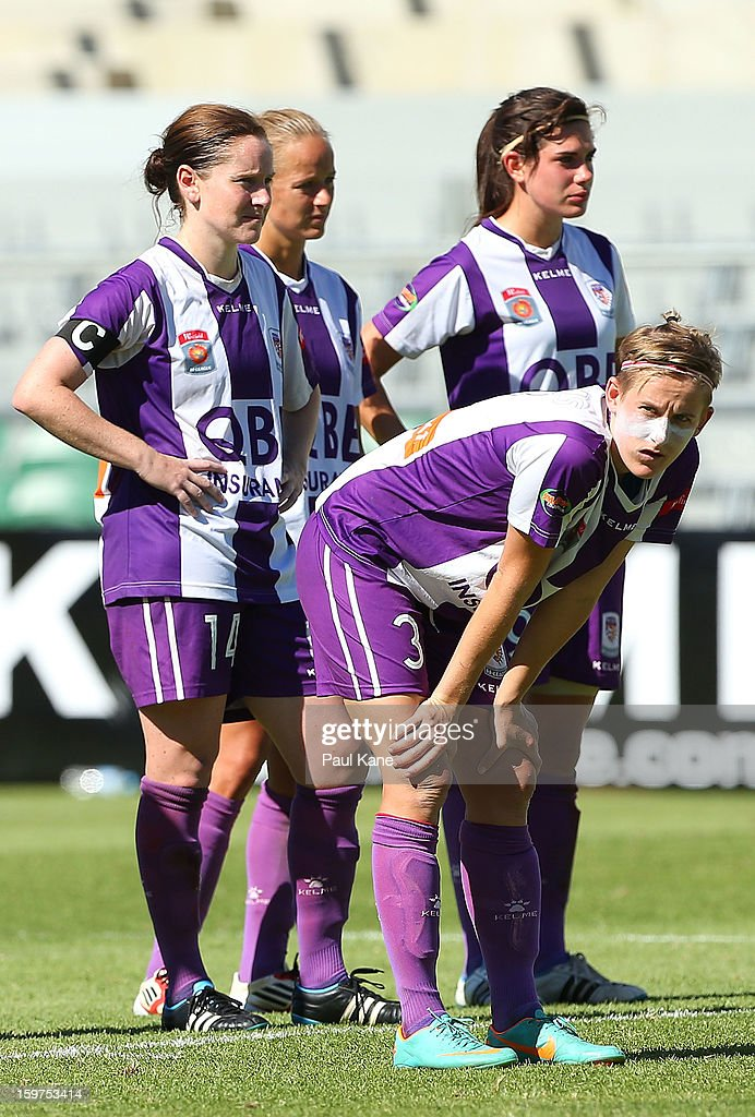 Collette McCallum, Rosie Sutton and Carys Hawkins of the Glory looks on after being defeated by penalty shoot-out during the W-League Semi Final match between Perth Glory and Melbourne Victory at nib Stadium on January 20, 2013 in Perth, Australia.