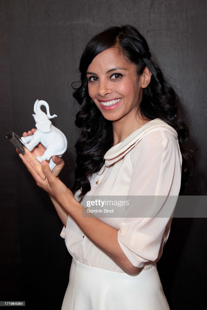 Collien Ulmen Fernandes attends the award event 'Kinder-Medien-Preis 2013 at Gasteig on June 30, 2013 in Munich, Germany.Cartoon Network's local production 'Cartoon Network Spurensuche - Schnitzeljagd war gestern' with host <a gi-track='captionPersonalityLinkClicked' href=/galleries/search?phrase=Collien+Ulmen-Fernandes&family=editorial&specificpeople=235967 ng-click='$event.stopPropagation()'>Collien Ulmen-Fernandes</a> was awarded at the event.