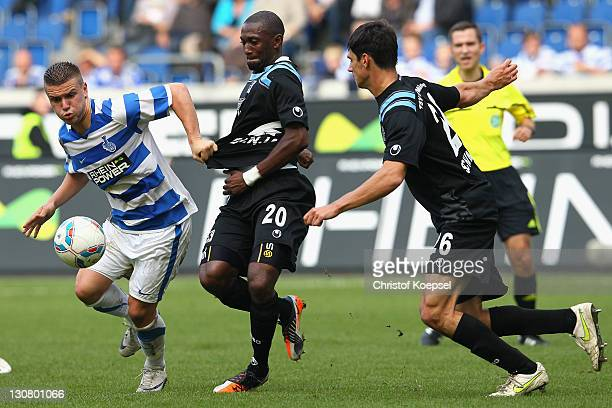 Collin Benjamin of Muenchen challenges Flamur Kastrati of Duisburg during the Second Bundesliga match between MSV Duisburg and TSV 1860 Muenchen at...
