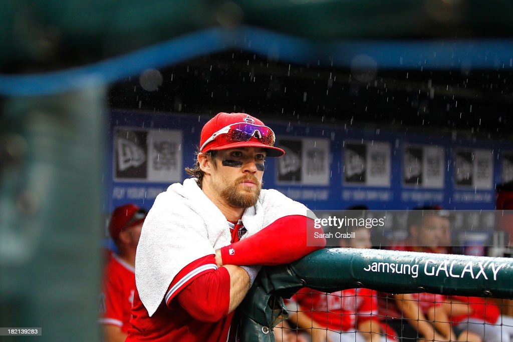 <a gi-track='captionPersonalityLinkClicked' href=/galleries/search?phrase=Collin+Cowgill&family=editorial&specificpeople=6888953 ng-click='$event.stopPropagation()'>Collin Cowgill</a> #19 of the Los Angeles Angels of Anaheim looks on from the dugout in the ninth inning during a game against the Texas Rangers at Rangers Ballpark in Arlington on September 28, 2013 in Arlington, Texas. The Texas Rangers defeated the Los Angeles Angels of Anaheim 7-4.