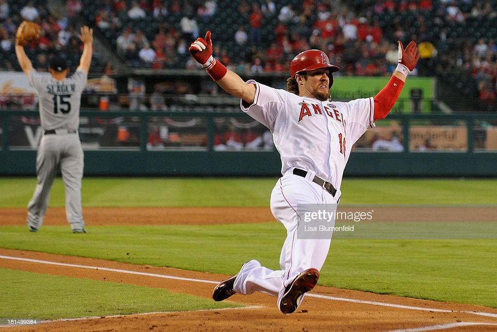 <a gi-track='captionPersonalityLinkClicked' href=/galleries/search?phrase=Collin+Cowgill&family=editorial&specificpeople=6888953 ng-click='$event.stopPropagation()'>Collin Cowgill</a> #19 of the Los Angeles Angels of Anaheim scores in the second inning against the Seattle Mariners at Angel Stadium of Anaheim on September 21, 2013 in Anaheim, California.