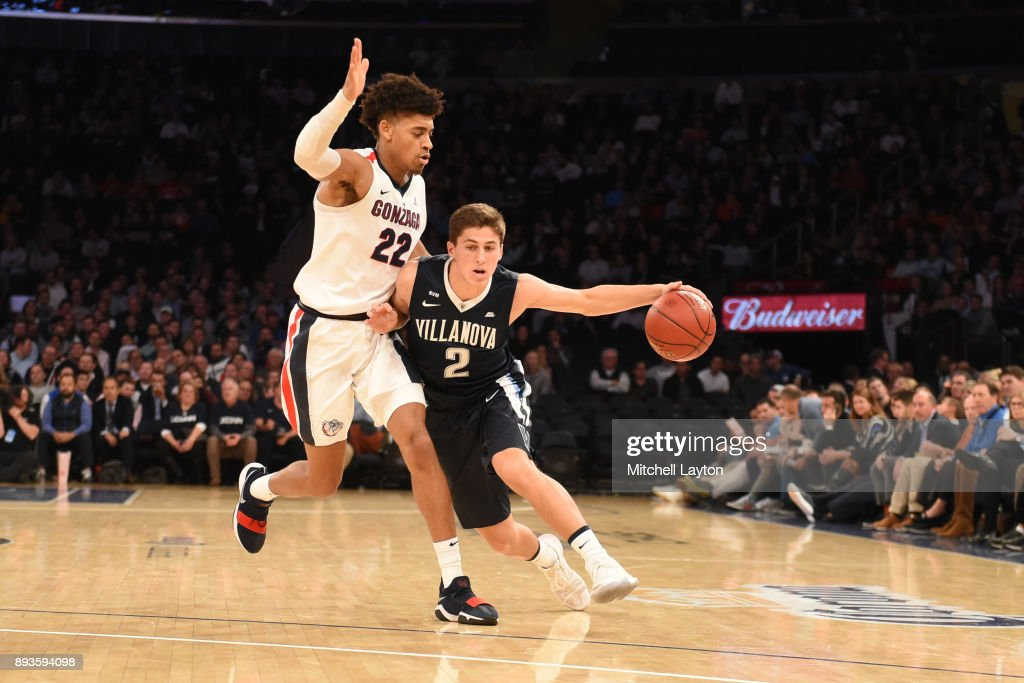 Collin Gillespie #2 of the Villanova Wildcats dribbles around Jeremy Jones #22 of the Gonzaga Bulldogs during the Jimmy V Classic college basketball game at Madison Square Garden on December 5, 2017 in New York City. The Wildcats won 88-72.