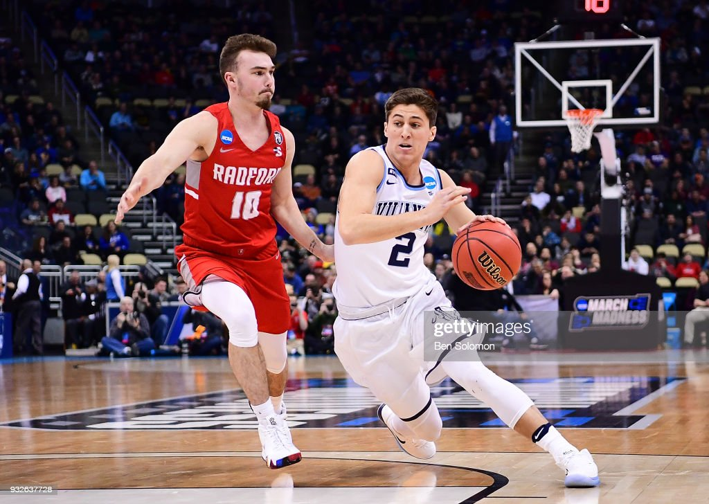 Collin Gillespie #2 of the Villanova Wildcats drives to the basket against Caleb Tanner #10 of the Radford Highlanders in the first half during the first round of the 2018 NCAA Men's Basketball Tournament held at PPG Paints Arena on March 15, 2018 in Pittsburgh, Pennsylvania.