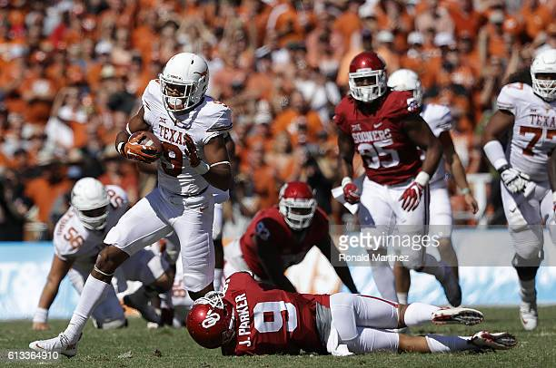 Collin Johnson of the Texas Longhorns runs the ball past Tay Evans of the Oklahoma Sooners at Cotton Bowl on October 8 2016 in Dallas Texas