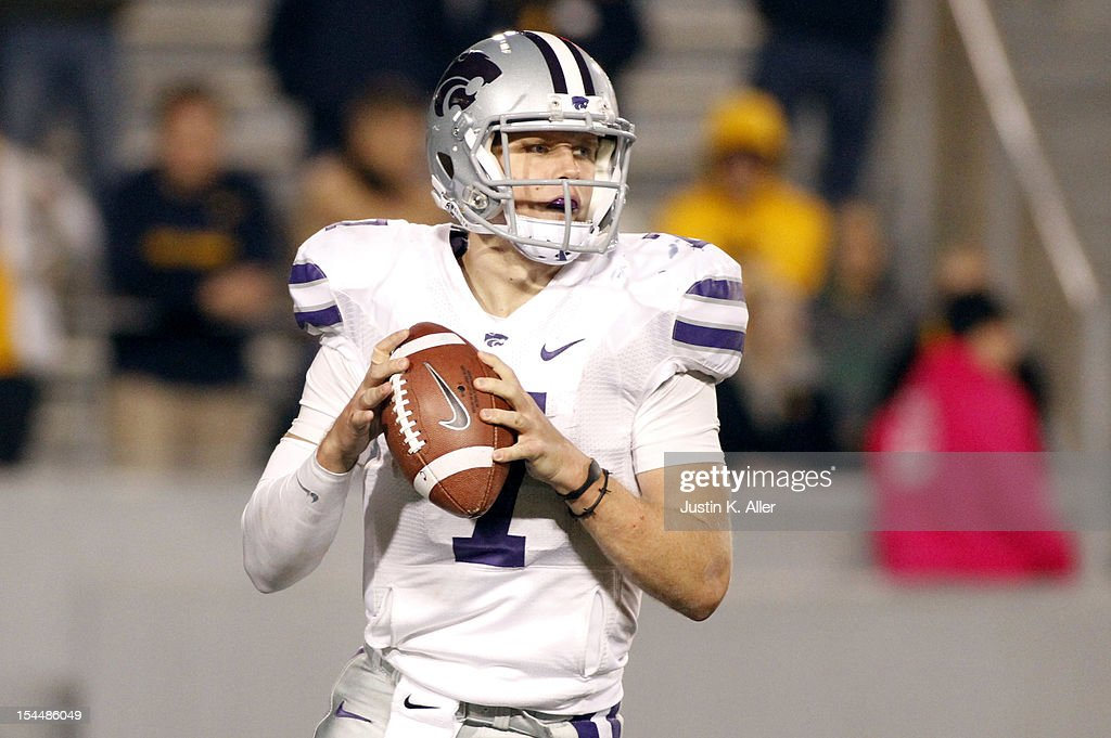 <a gi-track='captionPersonalityLinkClicked' href=/galleries/search?phrase=Collin+Klein&family=editorial&specificpeople=5838707 ng-click='$event.stopPropagation()'>Collin Klein</a> #7 of the Kansas State Wildcats drops back to pass against the West Virginia Mountaineers during the game on October 20, 2012 at Mountaineer Field in Morgantown, West Virginia. The Wildcats defeated the Mountaineers 55-14.