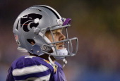 Collin Klein of the Kansas State Wildcats looks on from the bench in the third quarter against the Oregon Ducks during the Tostitos Fiesta Bowl at...