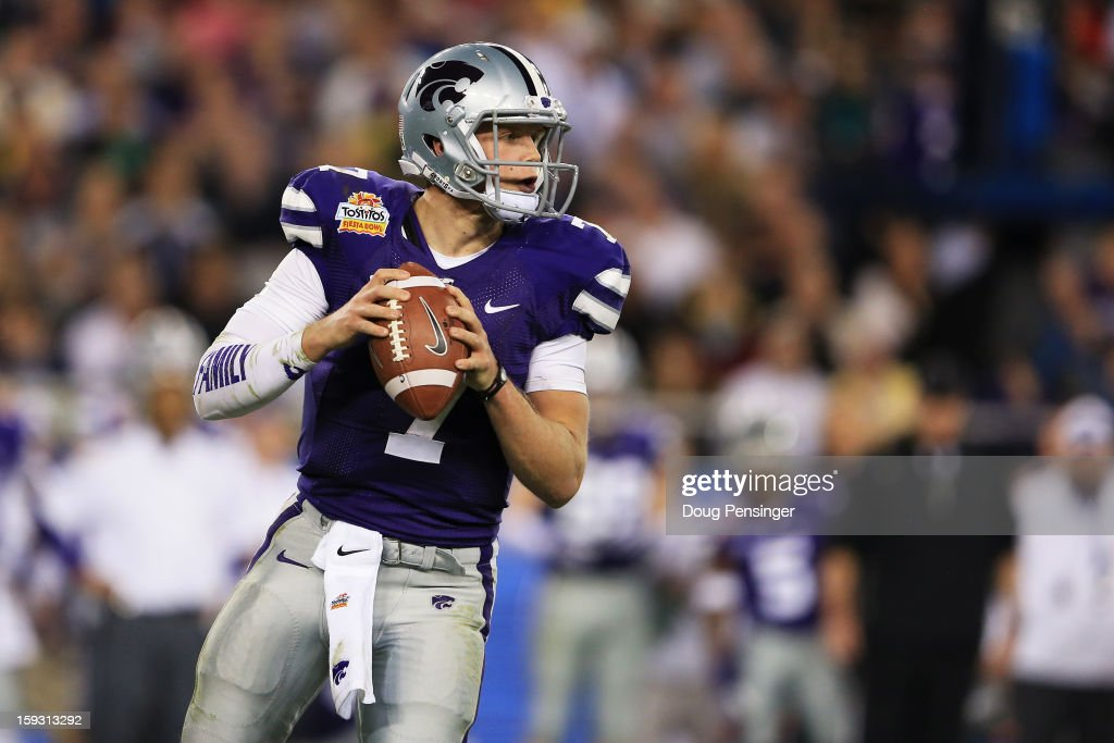 <a gi-track='captionPersonalityLinkClicked' href=/galleries/search?phrase=Collin+Klein&family=editorial&specificpeople=5838707 ng-click='$event.stopPropagation()'>Collin Klein</a> #7 of the Kansas State Wildcats looks to pass against the Oregon Ducks during the Tostitos Fiesta Bowl at University of Phoenix Stadium on January 3, 2013 in Glendale, Arizona.