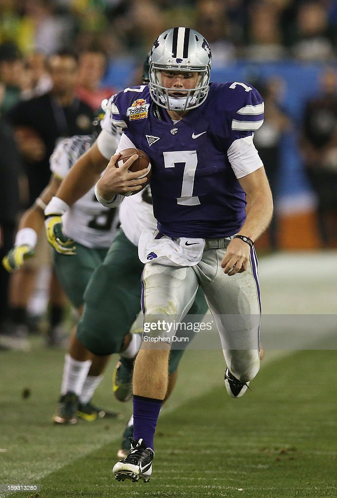 <a gi-track='captionPersonalityLinkClicked' href=/galleries/search?phrase=Collin+Klein&family=editorial&specificpeople=5838707 ng-click='$event.stopPropagation()'>Collin Klein</a> #7 of the Kansas State Wildcats runs the ball against the Oregon Ducks during the Tostitos Fiesta Bowl at University of Phoenix Stadium on January 3, 2013 in Glendale, Arizona.