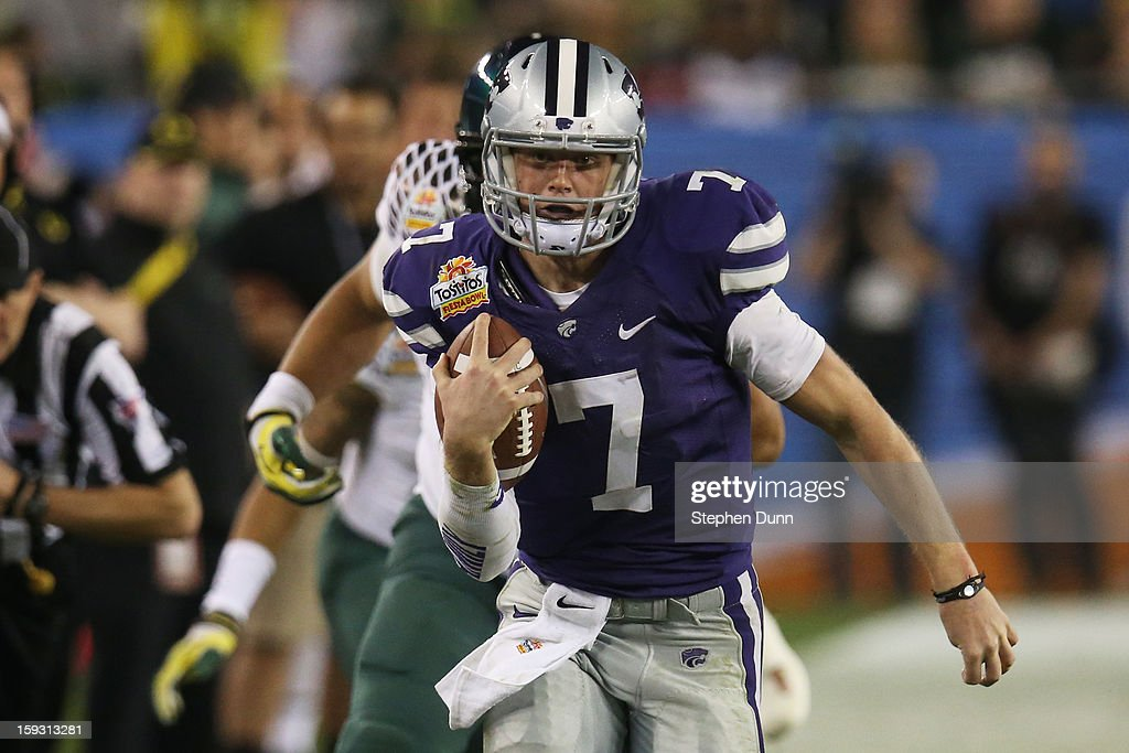 Collin Klein #7 of the Kansas State Wildcats runs the ball against the Oregon Ducks during the Tostitos Fiesta Bowl at University of Phoenix Stadium on January 3, 2013 in Glendale, Arizona.