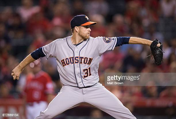 Collin McHugh of the Houston Astros pitches during the fifth inning of the game against the Los Angeles Angels of Anaheim at Angel Stadium of Anaheim...