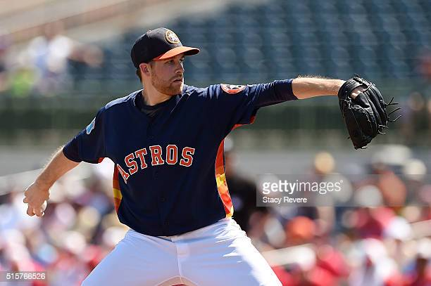 Collin McHugh of the Houston Astros throws a pitch during a spring training game against the Washington Nationals at Osceola County Stadium on March...