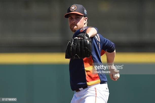 Collin McHugh of the Houston Astros throws a pitch prior to a spring training game against the Washington Nationals at Osceola County Stadium on...
