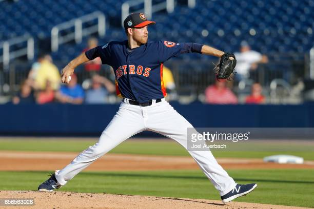 Collin McHugh of the Houston Astros throws the ball against the St Louis Cardinals in the first inning during a spring training game at The Ballpark...