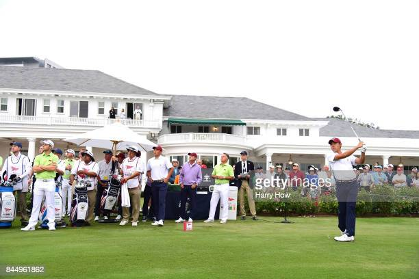 Collin Morikawa of Team USA tees off with partner Norman Xiong against Harry Ellis and Alfie Plant of Team Great Britain and Ireland during the...