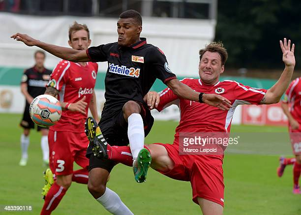 Collin Quaner of 1 FC Union Berlin and Markus Brzenska of FC Viktoria Koeln during the match between FC Viktoria Koeln and Union Berlin on August 8...